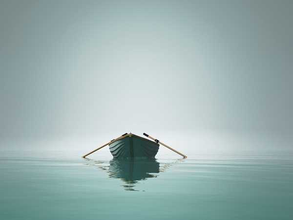 The sound of oars hitting the side of a wooden boat from within the mist